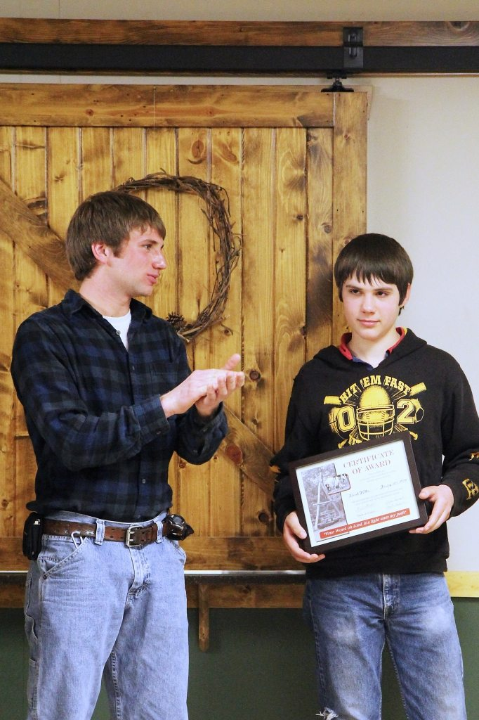 graduating from program for troubled youth